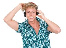 Smiling young man listening to music Royalty Free Stock Images