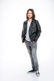 Smiling young man with long hair in black leather jacket Royalty Free Stock Images