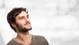 Smiling young man looking up Royalty Free Stock Image