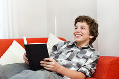 Smiling Young Man Loves to Read for Fun Royalty Free Stock Photos