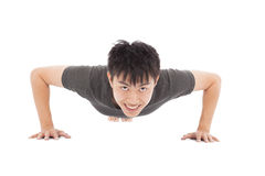 Smiling young man make push-ups and fitness Royalty Free Stock Image