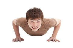 Smiling Young man makes push-up Stock Image