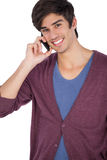 Smiling young man with mobile phone. Looking at the camera Royalty Free Stock Photography