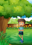 A smiling young man near the tree inside the gated yard Royalty Free Stock Photos