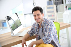 Smiling young man at office royalty free stock image