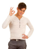 Smiling young man,  ok sign Royalty Free Stock Photos