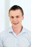 Smiling young man with orthodontic braces. Royalty Free Stock Photography