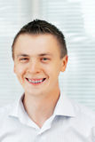 Smiling young man with orthodontic braces. Stock Photo