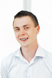 Smiling young man with orthodontic braces. Stock Images