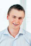 Smiling young man with orthodontic braces. Stock Photos