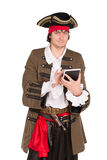 Smiling young man. In pirate costume posing with a tablet. Isolated on white Royalty Free Stock Photos