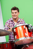 Smiling Young Man Playing Drums Stock Photo