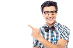 Smiling young  man pointing away Royalty Free Stock Photography