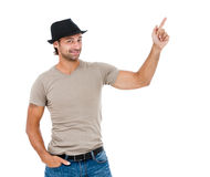 Smiling young man pointing copy space Stock Photos