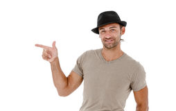 Smiling young man pointing copy space Stock Photo