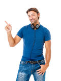 Smiling young man pointing copy space Royalty Free Stock Images