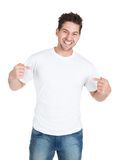 Smiling young man pointing itself Stock Photography