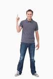 Smiling young man pointing up Royalty Free Stock Photos