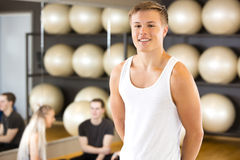 Smiling young man portrait at fitness gym Stock Images