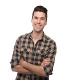 Smiling young man posing with arms crossed Royalty Free Stock Photography