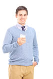 Smiling young man posing with a glass of milk Stock Images