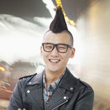 Smiling Young man with punk Mohawk and glasses, Looking at Camera Stock Image