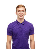 Smiling young man in purple polo t-shirt Royalty Free Stock Photo