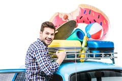 Man with lugagge on car ruff Stock Photos