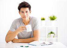 Smiling  young man reading  book Royalty Free Stock Photo