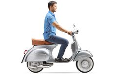 Smiling young man riding a vintage scooter stock images