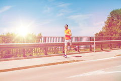 Smiling young man running at summer seaside Stock Photography