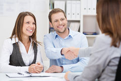 Smiling Young Man Shaking Hands With An Agent Royalty Free Stock Images