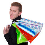 Smiling young man with shopping bags Royalty Free Stock Photography