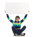 Smiling young man showing blank placard. Stock Photography