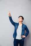 Smiling young man showing finger up Royalty Free Stock Images