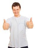 Smiling young man showing OK Stock Photos
