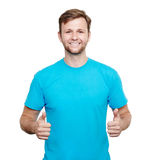 Smiling young man showing thumbs up Royalty Free Stock Photography