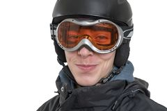 Smiling young man with ski helmet. And goggles, isolated on white Royalty Free Stock Photography