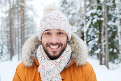 Smiling young man in snowy winter forest Stock Photo