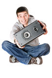 Smiling young man with a speaker Stock Photos