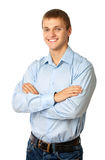 Smiling young man standing with his arms folded Royalty Free Stock Image