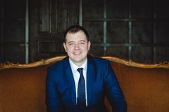 Smiling young man in suite royalty free stock image
