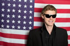 Smiling young man in sunglasses Royalty Free Stock Photography