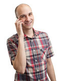Smiling young man talking on cell phone Stock Photography
