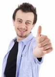 Smiling young man with thumb up Royalty Free Stock Images