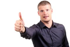 Smiling young man with thumb up Stock Photography