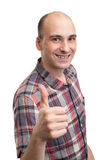 Smiling young man with thumbs up Stock Image