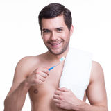 Smiling young man with a toothbrush. Stock Image