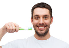 Smiling young man with toothbrush Royalty Free Stock Images