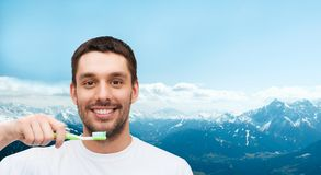 Smiling young man with toothbrush Royalty Free Stock Photos